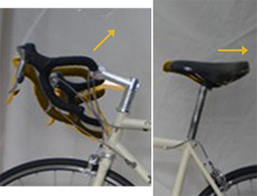 More relaxed - higher bars, saddle more to rear, less arched back